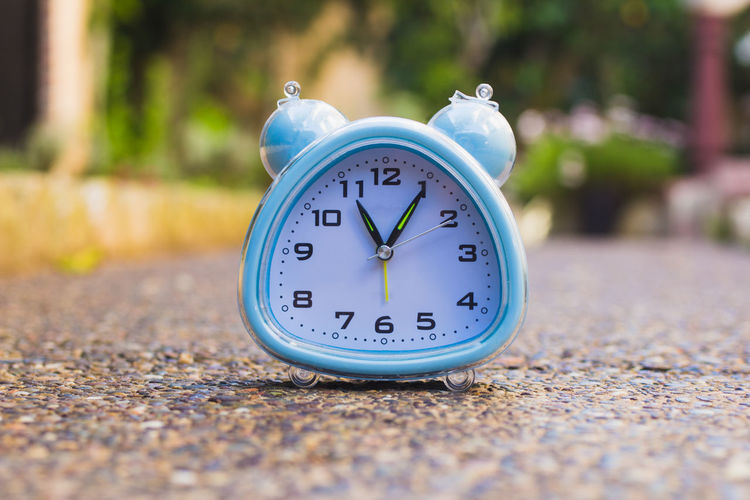 Last Chance Timing Alarm Clock Blue Clock Clock Face Clock Hand Close-up Day Focus On Foreground Last Call Minute Hand Nature No People Number Outdoors Selective Focus Shape Single Object Still Life Sunlight Surface Level Time Time To Reflect