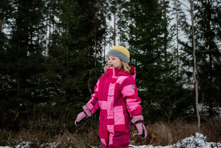 Full length of a girl standing on snow covered land