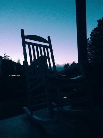 Empty chairs against clear sky