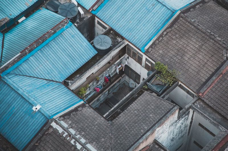 High angle view of houses by swimming pool in city