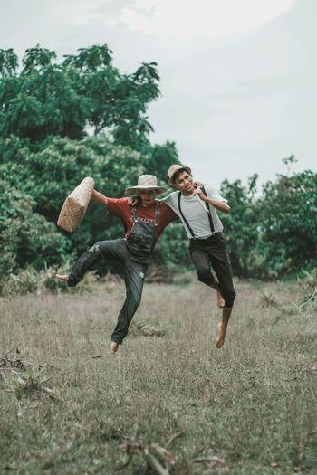 Full length of man jumping on field