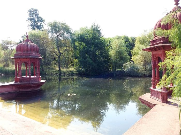 Krisna valley Spiritual center in Somogyvámos Hungary Hindu Temple Hindu Hinduism Hindu Culture Hindustan_times Hindu Style Tree Water Lake Clear Sky Reflection Sky Architecture Pavilion Pagoda