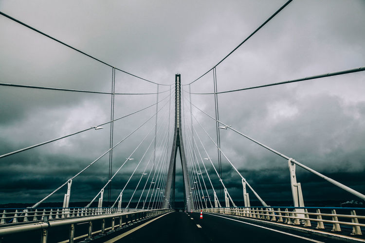 Pont de normandie against cloudy sky