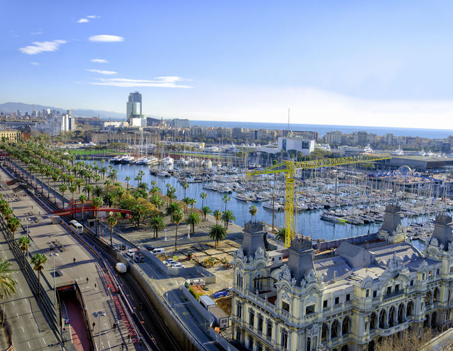 View of the Avenue in the Port in Barcelona, Spain Architecture Barcelona Center City Cityscape Downtown Famous Place SPAIN Spanish Tourist Travel View Building Cityscape Cloud - Sky Europe High Angle View Landmark Outdoors Residential District Sky Street Tourism Urban