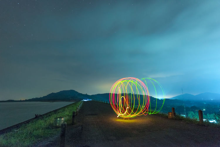 Light Painting On Road Against Sky At Night