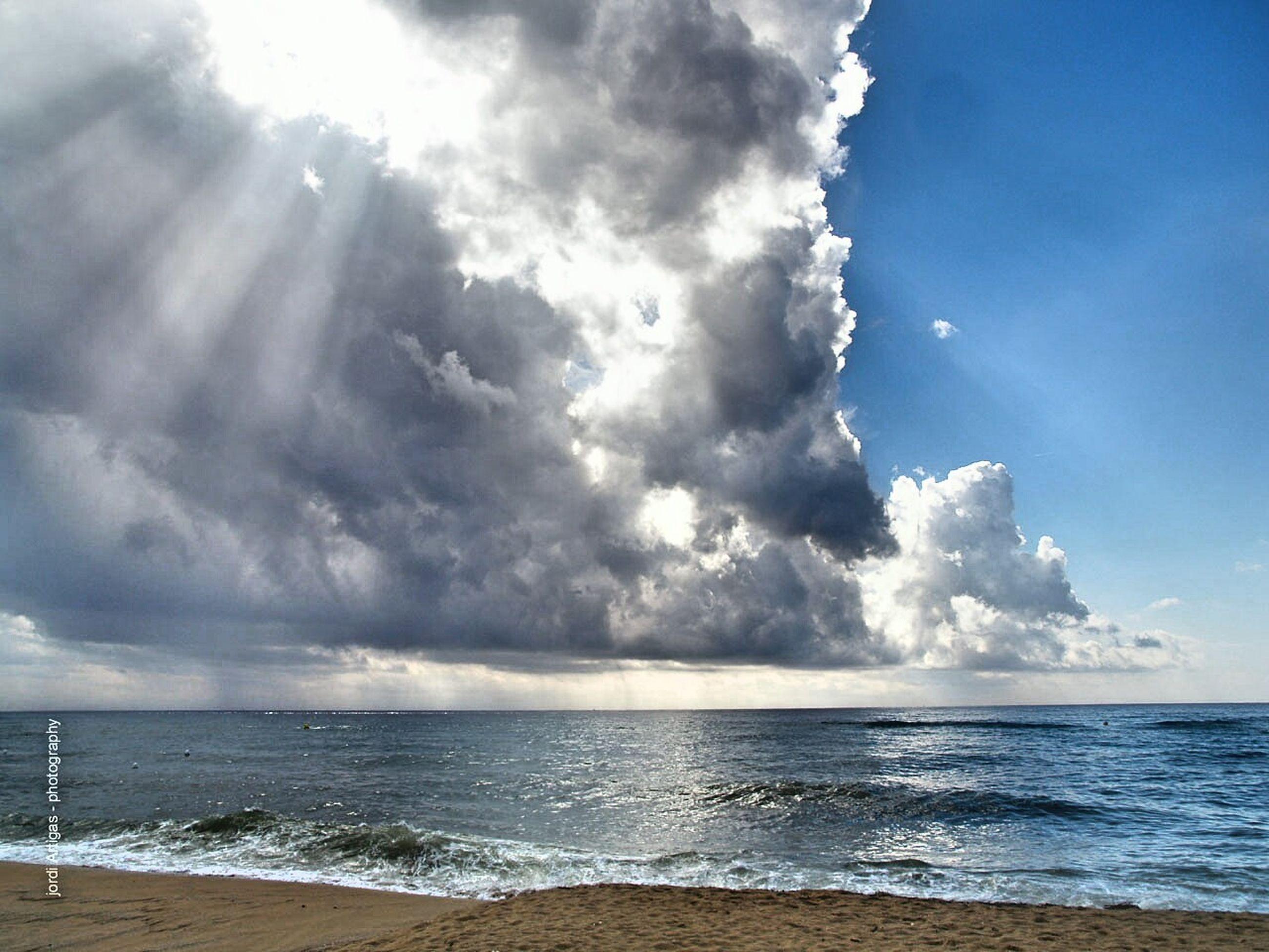 water, sea, horizon over water, beach, tranquil scene, scenics, tranquility, sky, beauty in nature, blue, idyllic, calm, shore, cloud, nature, seascape, non-urban scene, majestic, ocean, coastline, day, wave, outdoors, remote, vacations, cloud - sky, summer, tourism, coastal feature, solitude, tide, no people, cloudscape