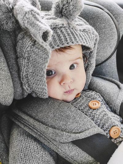 Portrait of cute baby girl in snow