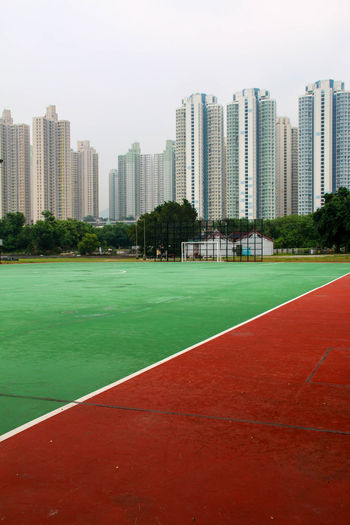 City Green Green Color HongKong Pupparazzi Red Skyscrapers Tennis Travel Photography Architecture Building Exterior Built Structure City Cityscape Eyeem Architecture Lover Football Field Modern No People Outdoors Red Color Skyscraper Soccer Soccer Field Sport Sportplatz The Graphic City