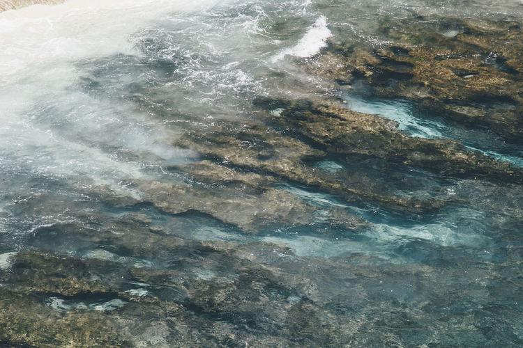 Full frame shot of rocks in sea