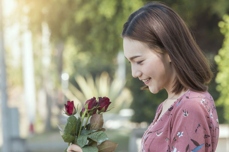 Gift for love Beauty In Nature Casual Clothing Day Females Flower Flower Head Flowering Plant Focus On Foreground Fragility Freshness Girls Hairstyle Headshot Leisure Activity Lifestyles Looking Nature One Person Outdoors Plant Real People Vulnerability  Women