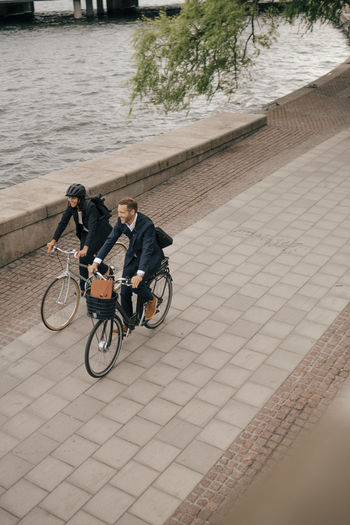 High angle view of people riding bicycle on footpath