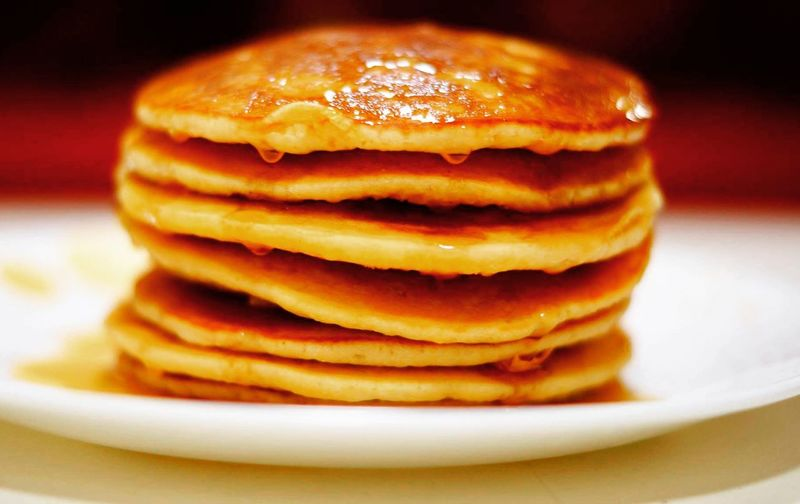 Close-up of stacked pancakes in plate on table