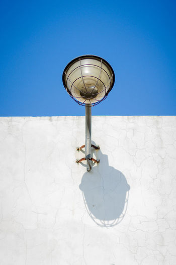 Street Light Blue Clear Sky Day Electric Lamp Electric Light Lighting Equipment Low Angle View No People Outdoors Sky Still Life Street Light Streetphotography Walking Around Wall