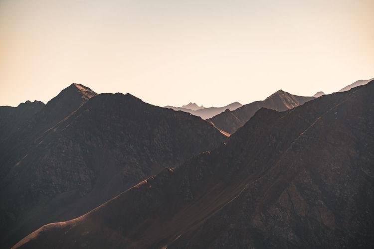 Layers of mountain ridges in the austrian alps in autumn.
