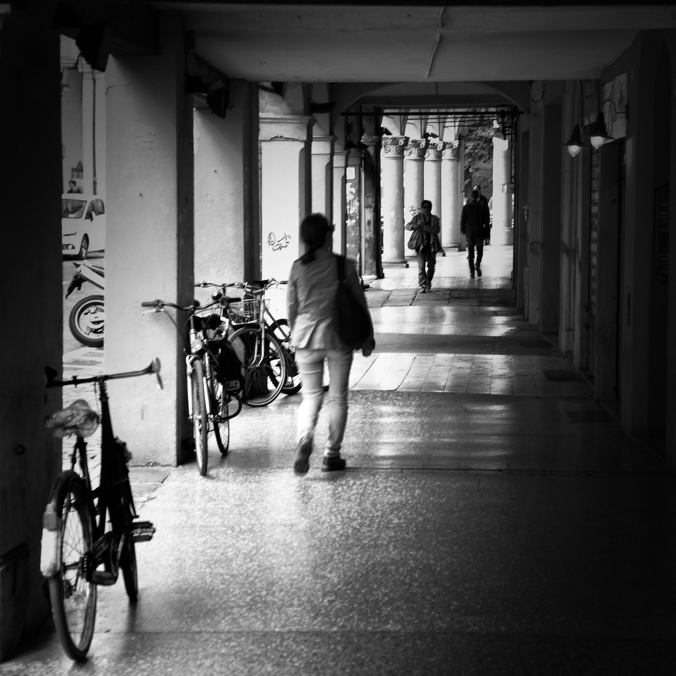 full length, men, walking, lifestyles, rear view, bicycle, indoors, architecture, person, transportation, built structure, leisure activity, the way forward, city life, casual clothing, mode of transport