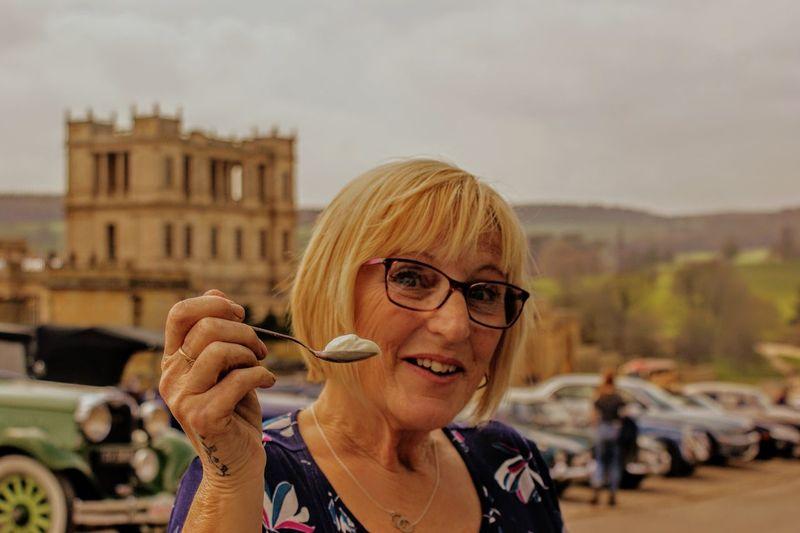 Portrait of woman having food in city
