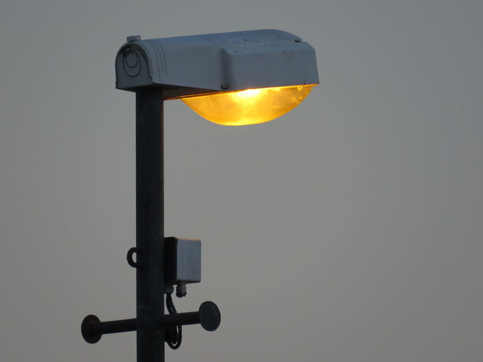 Low angle view of street light at sunset
