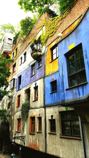 What do do when you have lots of cans with a little paint in each. Window Building Exterior Architecture Built Structure Low Angle View Day Outdoors No People Art Architecture Vienna Hundertwassers Buildings Village