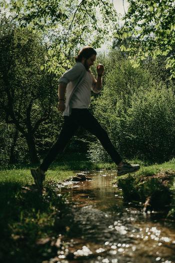 Man drinking water in lake
