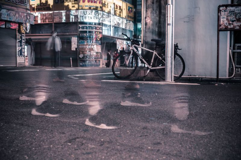 Bicycle on wet street at night