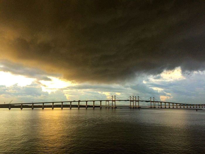 Dramatic Sky Cloud - Sky Outdoors Sunset Sky Scenics Sea Bridge - Man Made Structure Silhouette No People Water Nature Landscape Rural Scene Beach Storm Cloud Horizon Over Water Beauty In Nature Day Legend Palace Hotel View