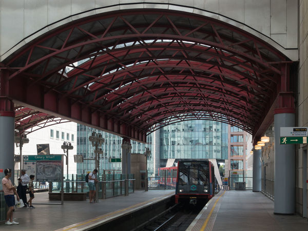 The Approach Canary Wharf DLR Docklands Light Railway Arch Arched Roof Architecture Built Structure City Day Incidental People Land Vehicle Mode Of Transportation Motion on the move Public Transportation Rail Transportation Railroad Station Railroad Station Platform Railroad Track Station Track Train Train - Vehicle Transportation Travel
