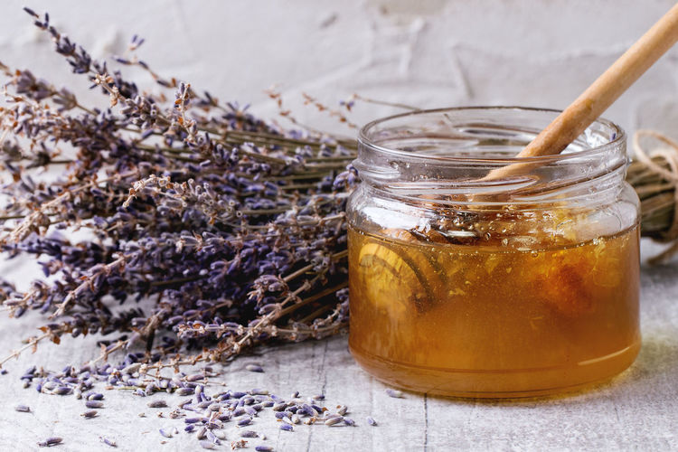 High angle view of honey with lavender flowers on table
