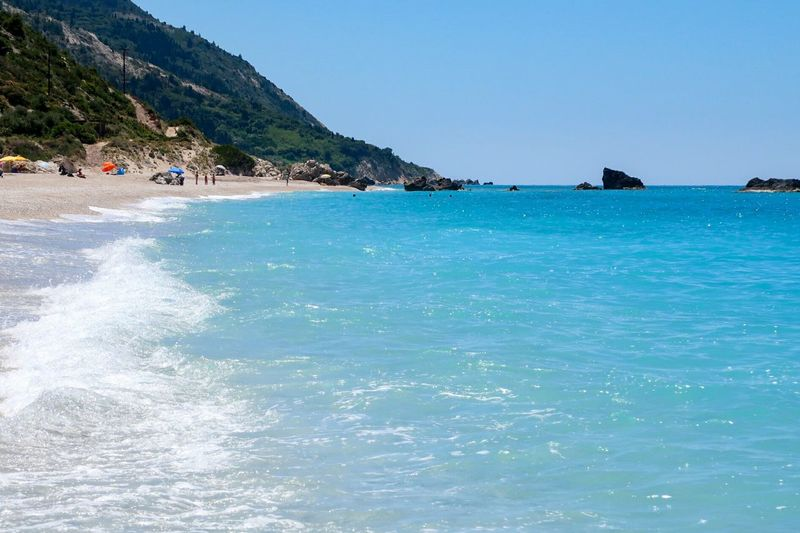 Tropical Climate Sunny Relaxation Travel Destinations Enjoyment Travel Lefkada Greece Kathisma Kathisma Beach Horizon Over Water Vacations Tranquil Scene Outdoors Nature Wave Water Shore Sea Beach Pebble Pebble Beach Summer Landscape Tourism Breathing Space