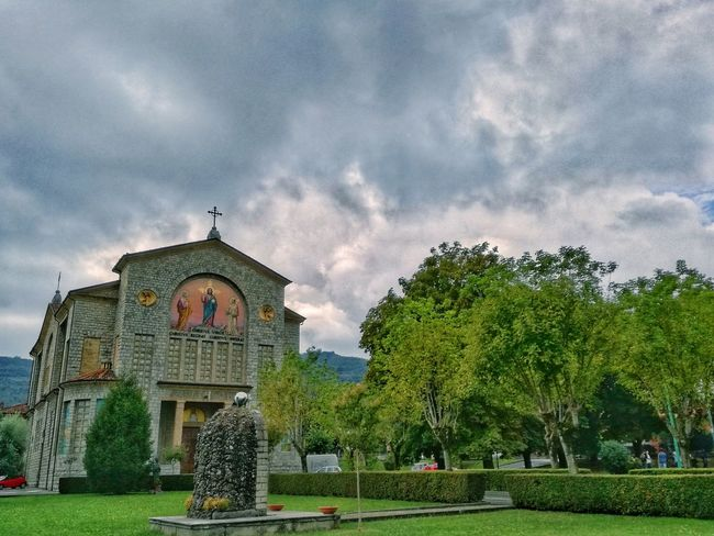 churchyard Architecture Building Exterior No People Bridge - Man Made Structure Cloud Cloudy Low Angle Viewhurchyard Built Structure Grass Place Of Worship Religion Spirituality Tree Sky Lawn Church Cloud - Sky Façade Cloud Outdoors Cloudy Travel Destinations Day Famous Place History
