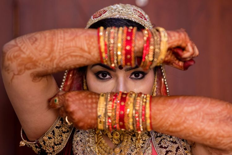 Portrait of young bride in traditional clothing
