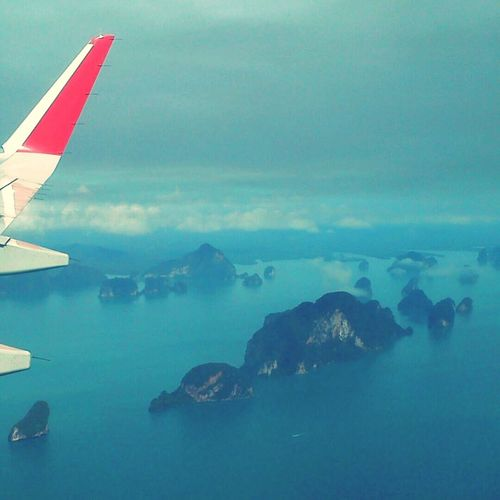 Fly to Phuket for visit & check center,weather not good ,the sky has more could and smoke. But look from airplane's view the sea and island look so fantastic! From An Airplane Window Phuket Sky_collection