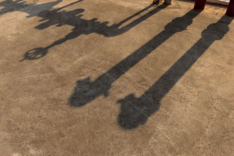 Shadow of machinery on footpath