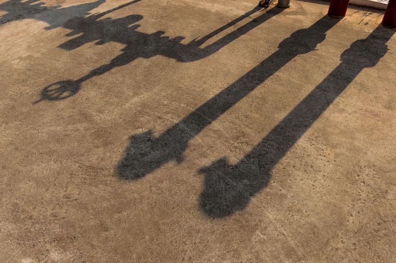 Shadow Of Machinery On Footpath