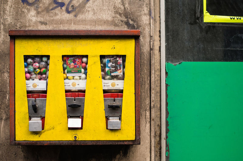 Close-up of vending machine on wall