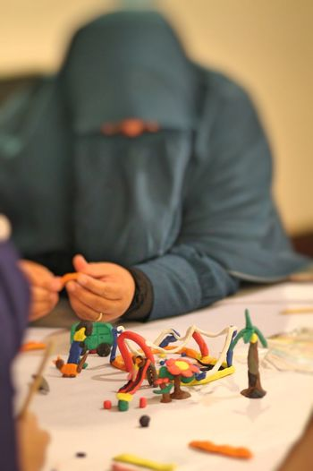 Front view of person working with clay models