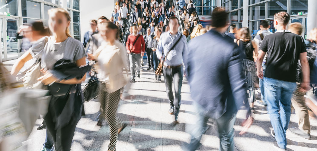 blurred business people at a trade fair Women Walkway Walking Visitors Visit Travel Transportation Train Trade Fair Trade Technology Street Speed Skywalk Show Sales Sale Rush Hour Real People People Outdoors Moving Motion Men Meeting Marketing London Lobby Lifestyles Large Group Of People Interior Hall Group Of People Group Future Fair Expo Exhibition Economy Day Crowded Crowd Convention Congress Conference Concept Commuters Commercial City Life City Casual Clothing Busy Business Booth Blurred Motion Blurred Banner Architecture Anonymous Airport Adult