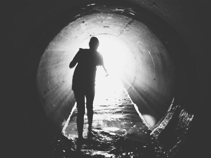 Tunnel Silhouette Adventure One Person Urban Landscape Portland Urban Exploration Stormdrain Infrastructure Water Surrealism Blackandwhite Monochrome Bnw The Week On EyeEm Walk Into The Light Mystery Discover Your City
