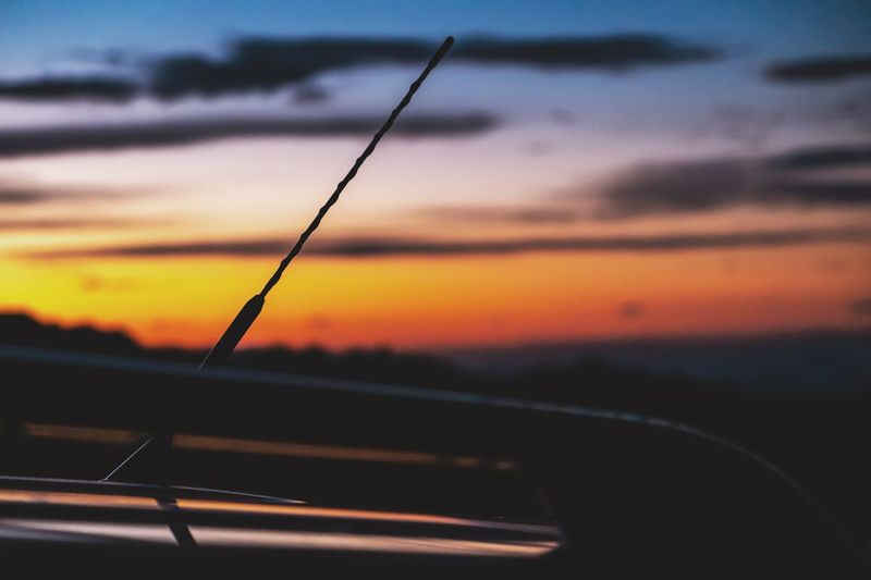 Close-up of silhouette car against sky during sunset