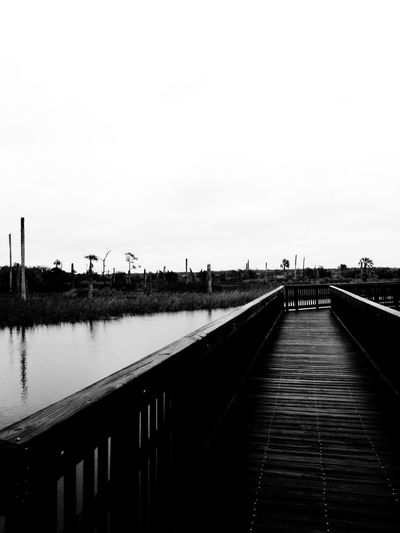 View of footbridge on lake