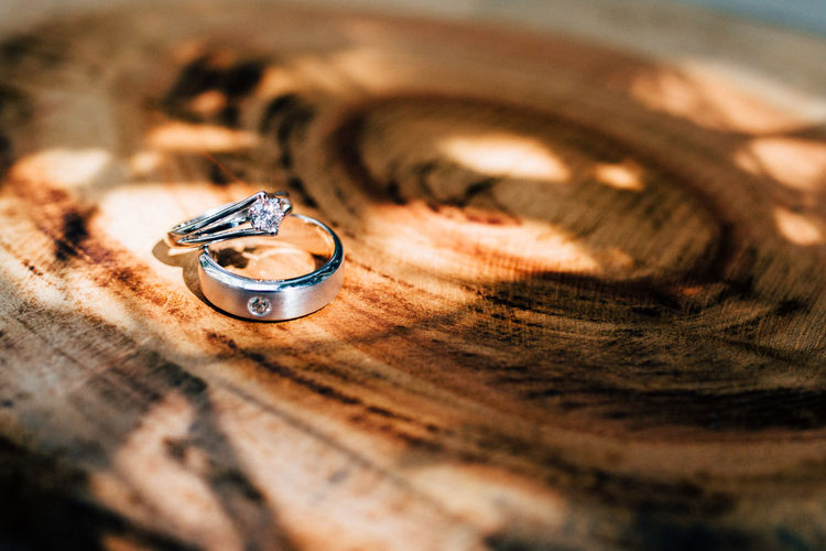 Close-Up Of Finger Ring On Wooden Table
