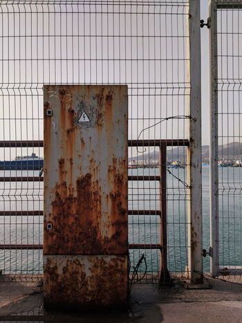 Cage Fence Bench Colors Sea Built Structure Building Exterior Horizon Over Water Metal Grate Construction