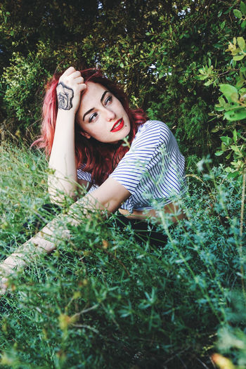 Plant Young Adult One Person Looking At Camera Portrait Young Women Leisure Activity Land Real People Green Color Tree Nature Women Lifestyles Adult Beauty Beautiful Woman Casual Clothing Fashion Hair Outdoors Hairstyle Contemplation Retro Styled
