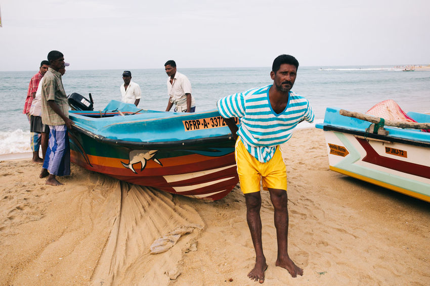 Travel in Sri Lanka Adventure Beach Casual Clothing Day Discovery Exotic Exploring Full Length Horizon Over Water Leisure Activity Mode Of Transport Nature Nautical Vessel Real People Sand Sea Sri Lanka Standing Transportation Travel Travel Photography Traveling Vacations Water The Photojournalist - 2017 EyeEm Awards Let's Go. Together.