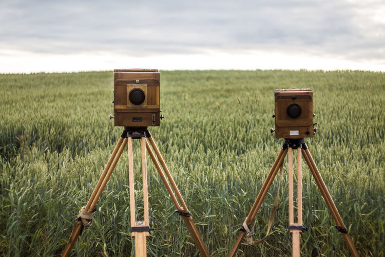 Belarus Camera - Photographic Equipment Close-up Cloud - Sky Day Field Focus On Foreground Grass Landscape Nature No People Outdoors Photography Themes Scenics Sky Technology