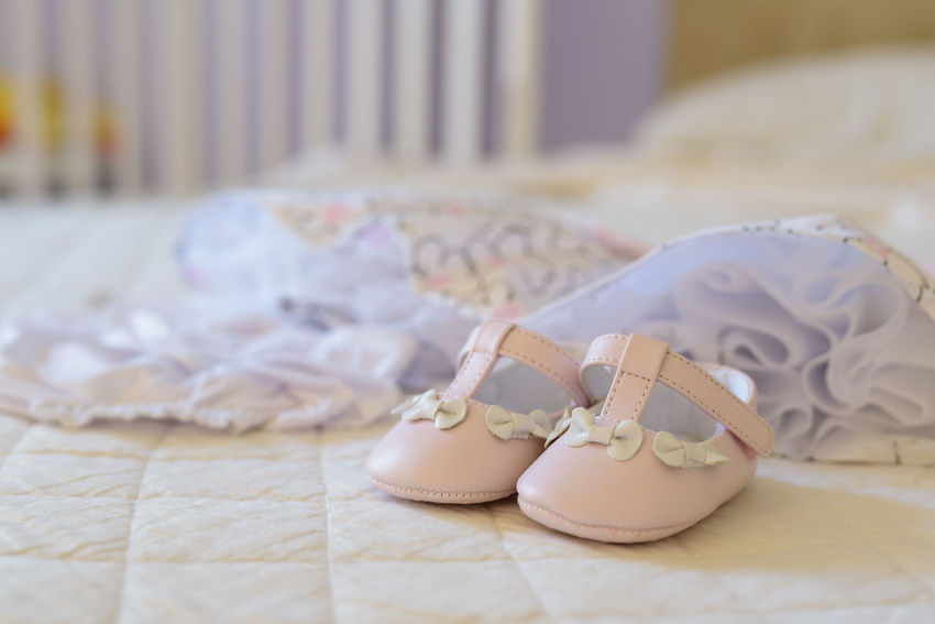 Bay girl clothes for christening day Baby Dress Babygirl Celebration Christening Day Close-up Emotion Event Focus On Foreground Life Events Love No People Pair Positive Emotion Selective Focus Shoe Still Life White Color