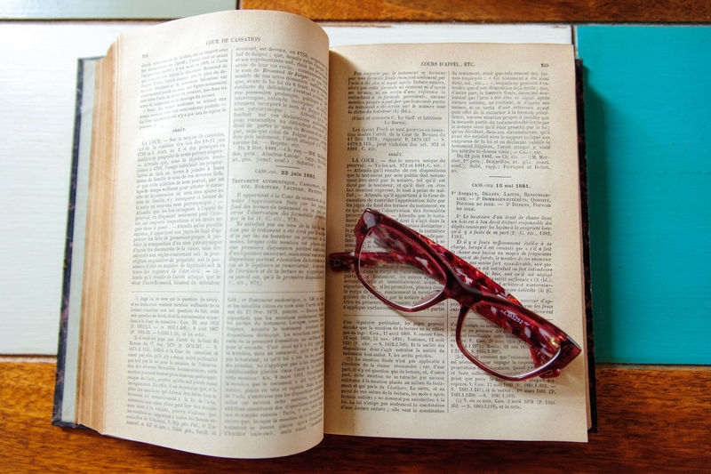 Glasses Book Eyeglasses  Education Publication Text Paper Communication Open Indoors  Page Learning Western Script No People Expertise Literature Table Close-up Still Life Textbook Reading Glasses Studying