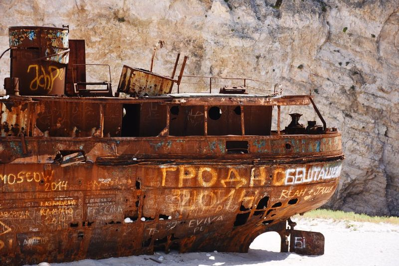 Close-up side view of abandoned boat