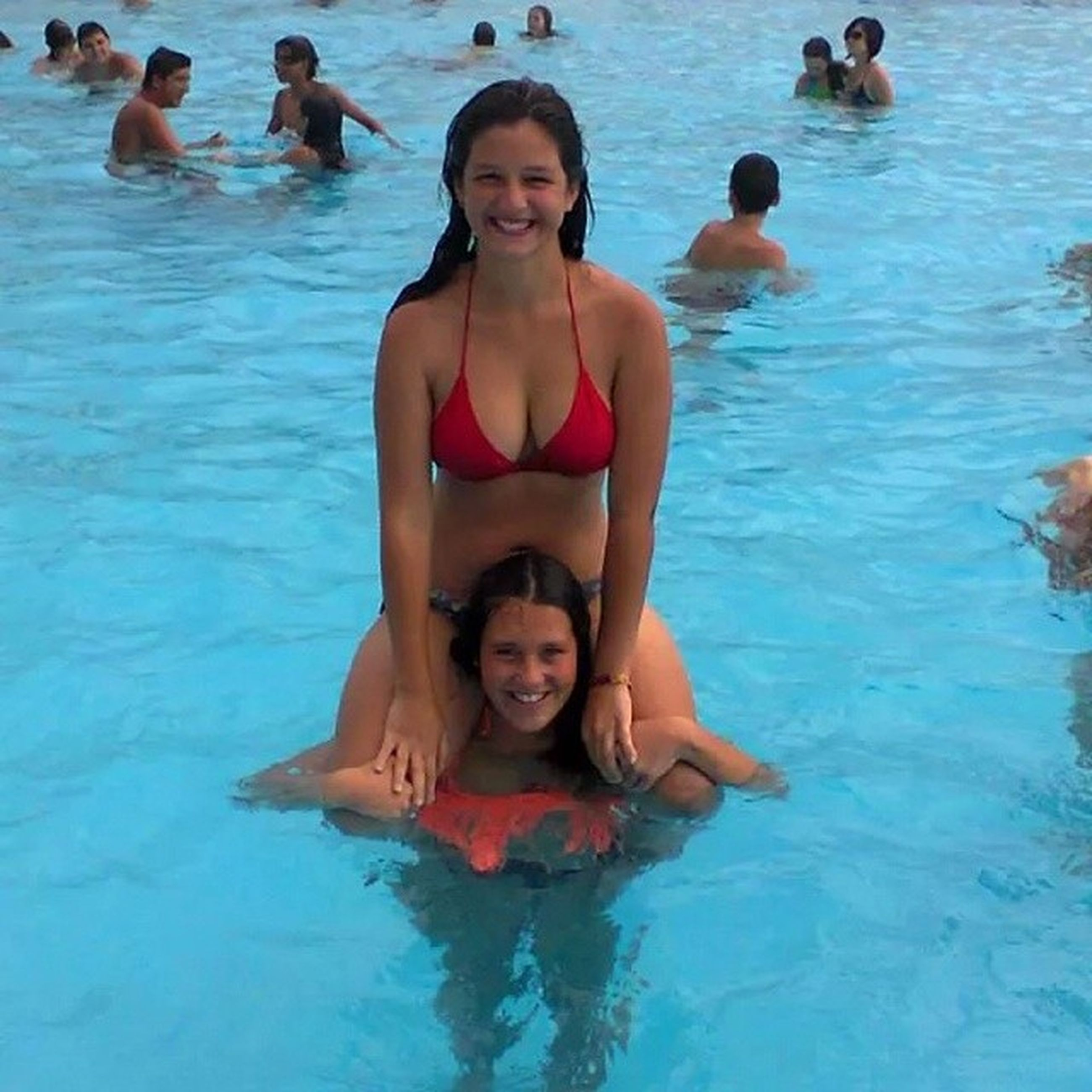 water, person, smiling, leisure activity, looking at camera, togetherness, portrait, happiness, lifestyles, childhood, front view, enjoyment, fun, vacations, swimming, bonding, girls, elementary age, full length