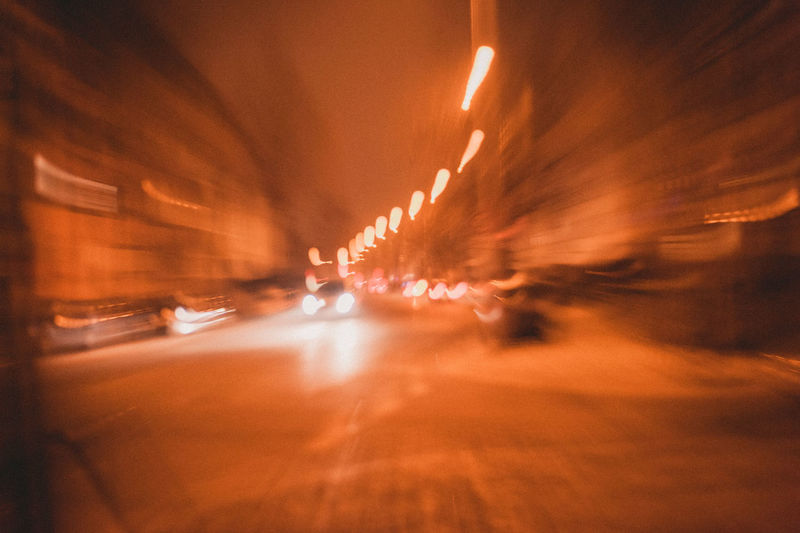 Motion Blurred Motion Illuminated Transportation Mode Of Transportation Car Motor Vehicle Land Vehicle City Street Night Speed Long Exposure Road Vehicle Interior No People Architecture on the move Travel Defocused Light