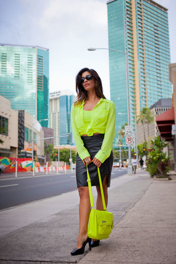 Portraits in Honolulu Diverse Faces Architecture Beautiful Woman Brunette Building Exterior Businesswoman City Day Front View Full Length Leisure Activity Lifestyles Long Hair Mid Adult Mid Adult Women Mini Skirt Neon Neon Yellow One Person Outdoors People Real People Sky Smiling Standing Young Women EyeEmNewHere Inner Power